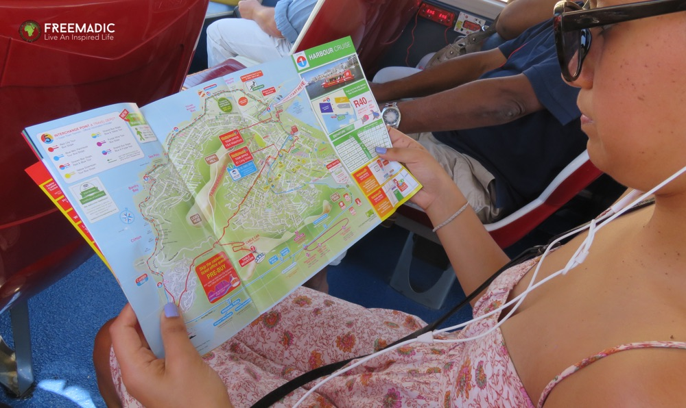freemadic_cape_town_citysightseeing_bus_lara_reading_map